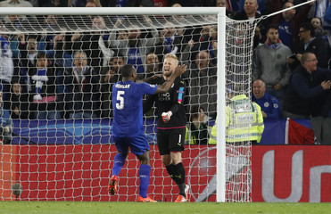 Leicester City's Kasper Schmeichel celebrates with Wes Morgan after saving a penalty