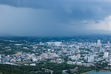 A view of the city from a window from a high point during a rain and Rain clouds at Thailand