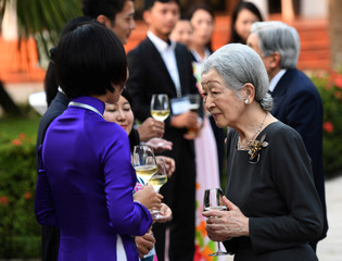 Japan's Emperor Akihito and Empress Michiko chat with Japanese volunteers from Japanese International Cooperation Agency (JICA), in the central city of Hue