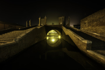 Triple-bridge, Ponte dei Trepponti, called Ponte Pallotta,famous bridge in Comacchio town, Italy