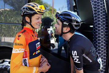 British cyclist Lizzie Armitstead-Deignan talks with her husband Sky rider Philip Deignan before the start of the 7th stage of Paris Nice cycling race