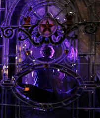 Leaded windows frame Danny Golden while he performs in the Victorian Room at The Driskill at the South by Southwest Music Film Interactive Festival 2017 in Austin