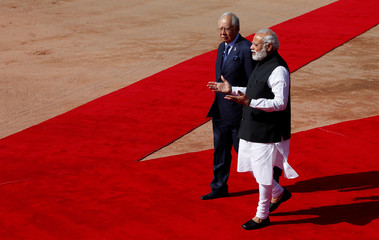 Malaysia's Prime Minister Razak talks to his Indian counterpart Modi during his ceremonial reception at the forecourt of India's Rashtrapati Bhavan presidential palace in New Delhi