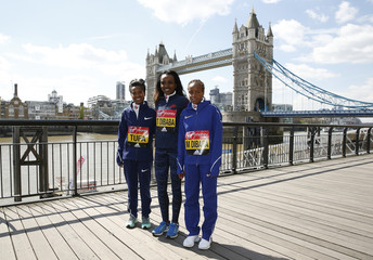 (L-R) Tigist Tufa, Tirunesh Dibaba and Mare Dibaba of Ethiopia pose for a photo in front of Tower Bridge ahead of the 2017 Virgin Money London Marathon