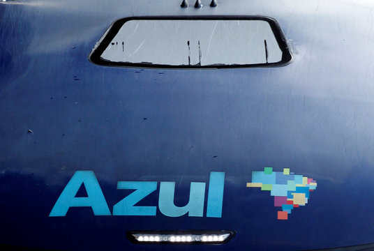 The logo of Brazil's airline Azul is seen on the roof of a bus at Viracopos airport in Campinas