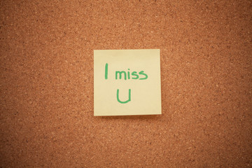 Miss you note on cork board