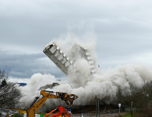 The Bonn Center topples during a controlled demolition in Bonn