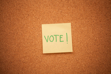 Vote note on cork board