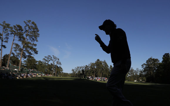 Phil Mickelson of the U.S. is silhouetted as he walks to the 14th tee during the 2017 Masters in Augusta