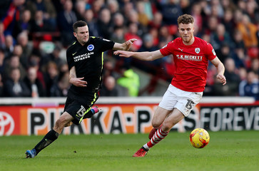 Britain Soccer Football - Barnsley v Brighton & Hove Albion - Sky Bet Championship - Oakwell - Marley Watkins of Barnsley in action with Jamie Murphy of Brighton & Hove Albion