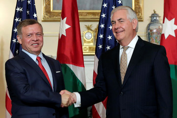U.S. Secretary of State Rex Tillerson shakes hands with Jordanian King Abdullah II Bin Al Hussein before their working luncheon at the State Department in Washington