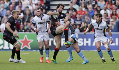 Marcelo Bosch of Saracens and Lee Jones of Glasgow Warriors