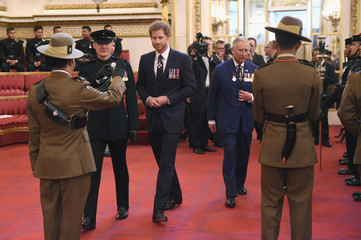 Britain's Prince Charles, Prince of Wales and Prince Harry attend a medal presentation for The Royal Gurkha Rifles at Buckingham Palace, London