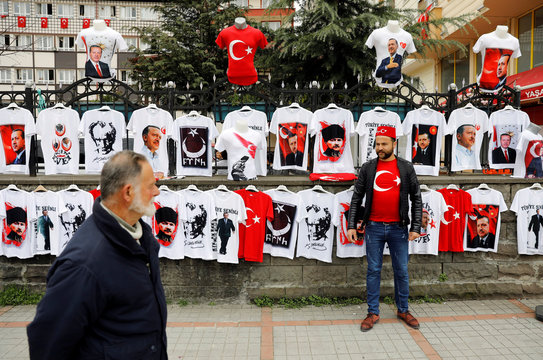 A street vendor sells t-shirts with portraits of modern Turkey's founder Mustafa Kemal Ataturk and Turkish President Tayyip Erdogan during a rally for the upcoming referendum in the Black Sea city of Rize