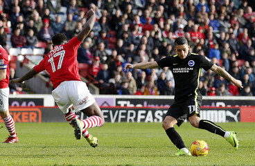 Anthony Knockaert of Brighton & Hove Albion in action with Andy Yiadom of Barnsley