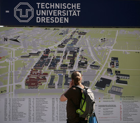 A man looks at a map of the campus of the Technical University of Dresden