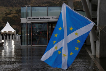 A Scottish Saltire flag flies outside the Scottish Parliament following suspension of the referendum debate in Edinburgh Scotland