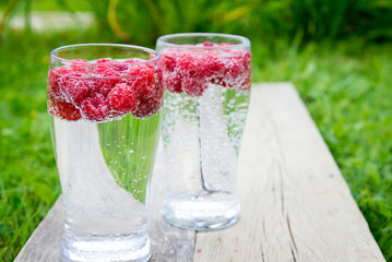 refreshing summer drink with sparkling water and fresh berries