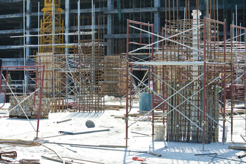 Column timber form work and reinforcement bar at the construction site in Malacca, Malaysia. The structure supported by temporary wood support