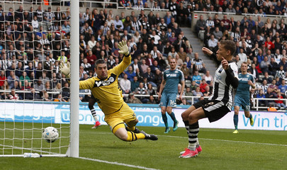 Newcastle United's Dwight Gayle scores their first goal
