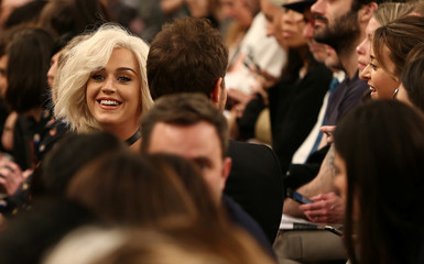 U.S. singer Katy Perry sits in the audience of the Christopher Kane catwalk show during London Fashion Week in London