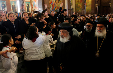 Relatives mourn the victims of the Palm Sunday bombings during the funeral at the Monastery of Saint Mina in Alexandria
