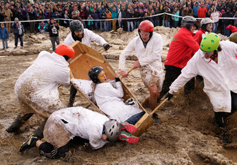 """The Nerds team drops their coffin allowing the Eldora Mountain team to take the lead in the coffin races at the yearly """"Frozen Dead Guy Days"""" festival inspired by a frozen corpse in Nederland"""
