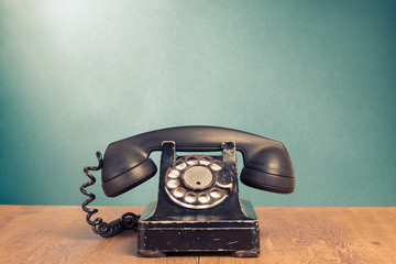 Retro black telephone on wooden table