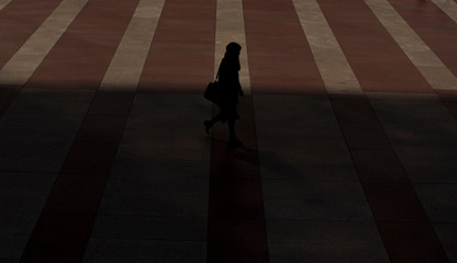 Woman walks through a yard in a business area in Madrid