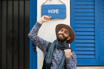 Cheerful man pointing on sign