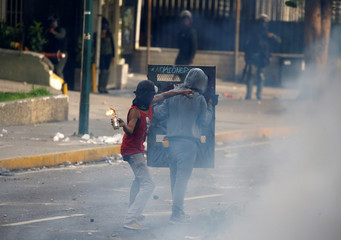 """Opposition demonstrators clash with riot police during the so called """"mother of all marches"""" against Venezuela's President Nicolas Maduro in Caracas"""