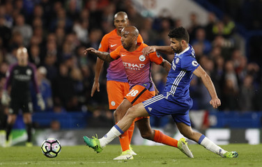 Manchester City's Fabian Delph in action with Chelsea's Diego Costa
