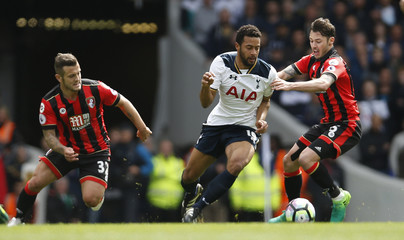 Tottenham's Mousa Dembele in action with Bournemouth's Adam Smith and Jack Wilshere