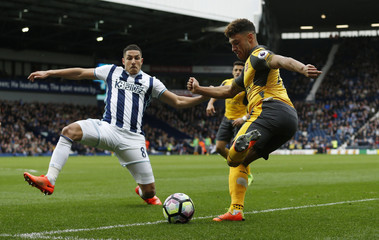 West Bromwich Albion's Jake Livermore in action with Arsenal's Alex Oxlade-Chamberlain