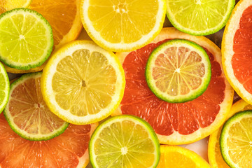 Wall Murals Slices of fruit Grapefruit, lime, lemon, and orange slices background