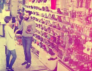 Couple choosing sneakers in store
