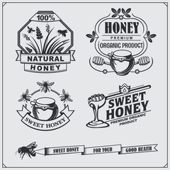 Set of honey labels, badges, emblems and design elements.