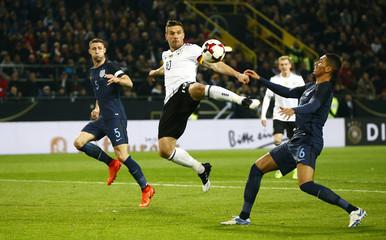 Germany's Lukas Podolski shoots at goal