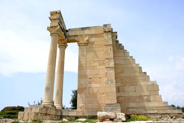 Architecture from the sanctuary of Apollon Hylates and cloudy blue sky