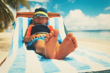little boy relax at summer beach
