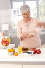 Mature woman making healthy breakfast