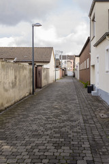 Narrow alley surrounded by both sides of old houses