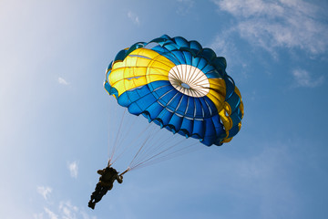 Parachute on background blue sky.