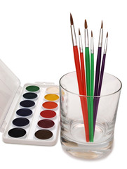 Watercolors paint art  and brush on paper