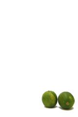 fresh green lime over white background