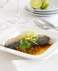 Pickled mackerel in a sauce on a plate