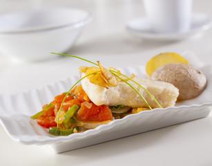 Grouper fillet served with fried garlic an vegetables.Grouper fillet served with fried garlic an vegetables.