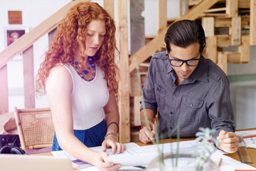 Two young architects in office