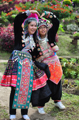 The tourists wear tribal costumes of Miao Tribal to enjoy for take photo, Thailand