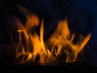 Flame and smoke of fire on a black background closeup